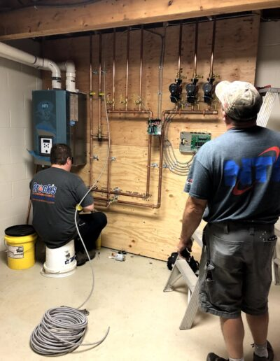 Techs installing heating system